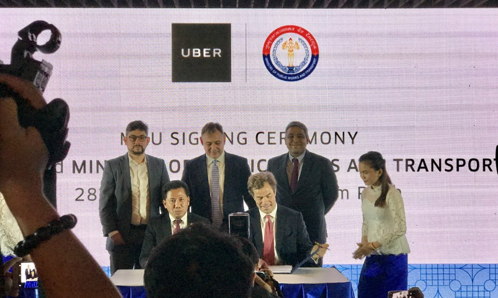 The MOU Signing between H.E. Pheng Sovicheano and Uber's Brooks Entwistle
