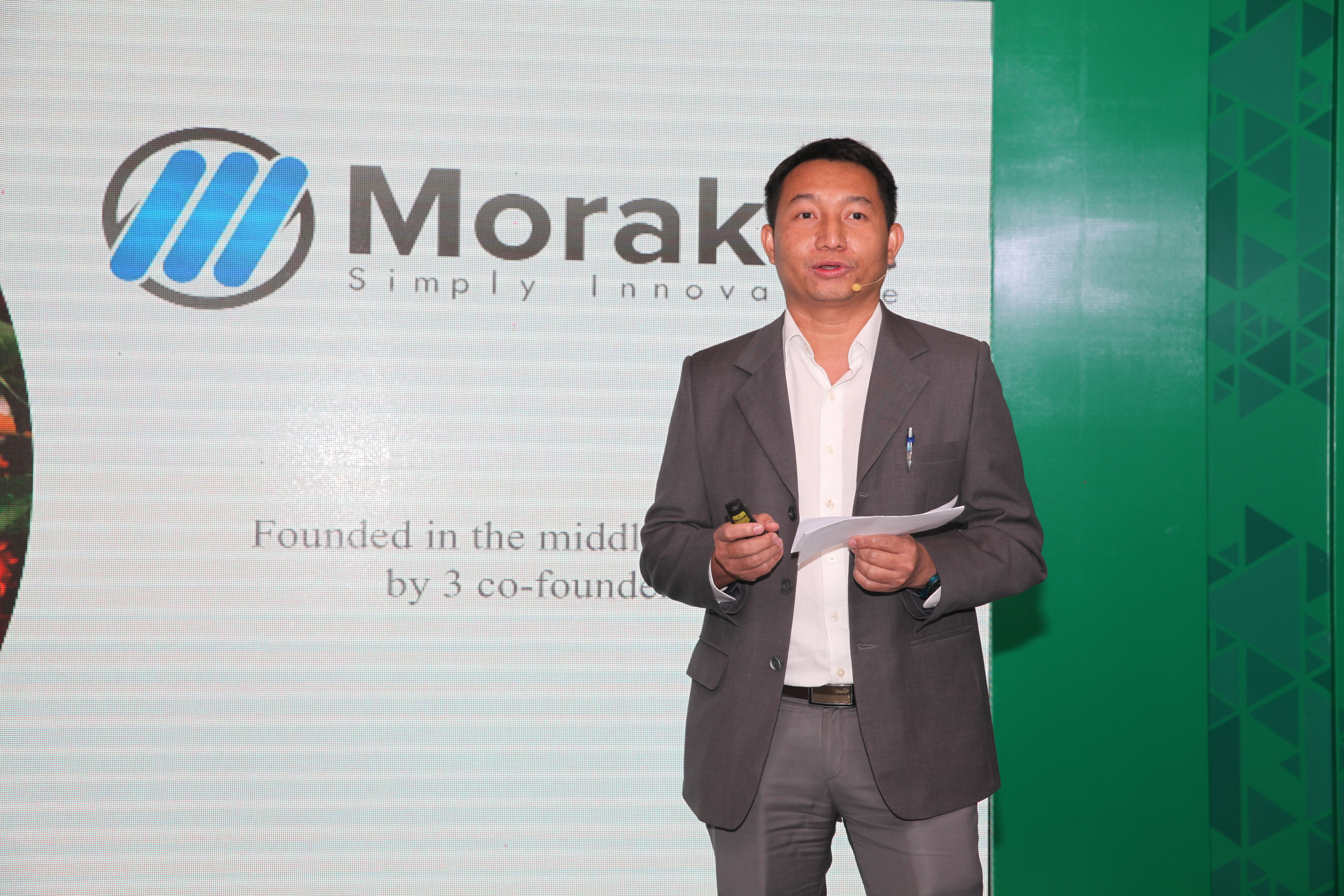 Morakot sharing more about their company for those present at the event