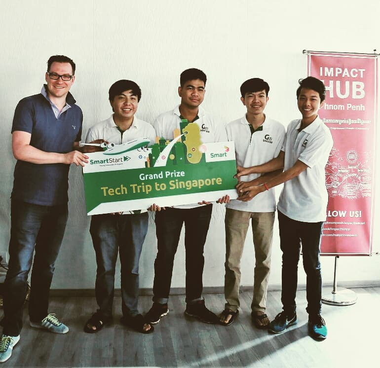 "Winning Team, GoSoccer, receiving their ""Tech Trip"" to Singapore Grand Prize from Smart Axiata CEO, Thomas Hundt Photo Source: Impact Hub Phnom Penh Facebook Page"